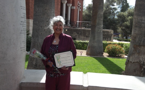 Colorado River Indian Tribes honoree Veronica Lee Homer under the arch