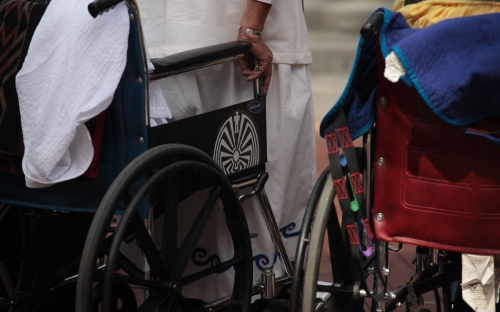 Detail of wheelchair in crowd