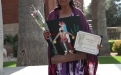 Pascua Yaqui honoree Maria Liceria Valencia with gifts from family